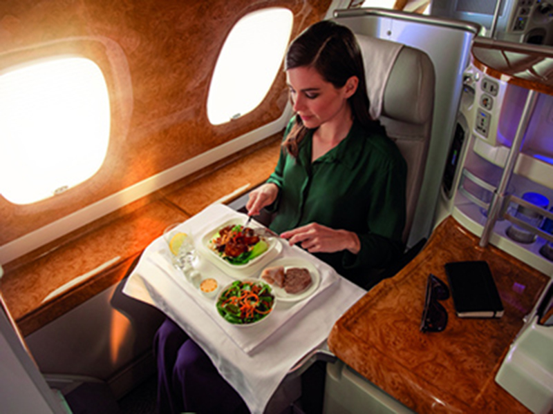 woman eating in business class travel
